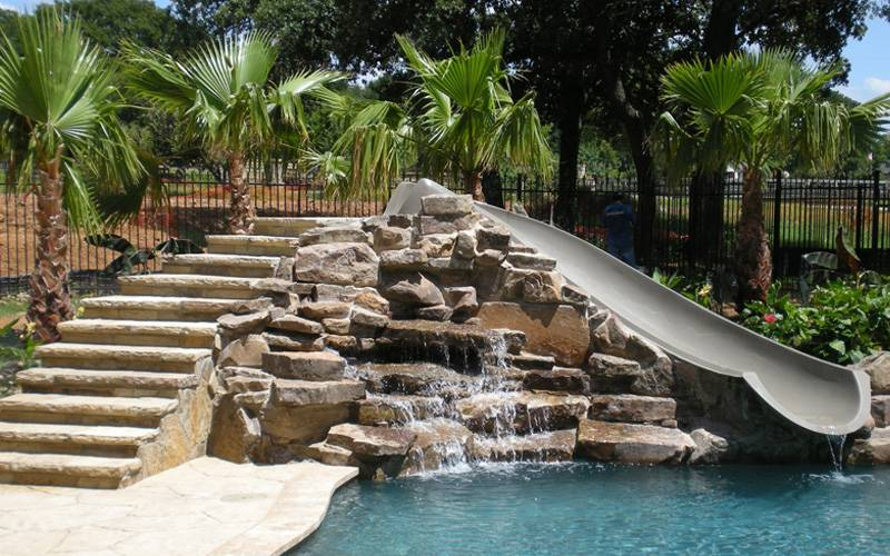 Custom Pool Slides & Fiberglass Residential Water Slides | Dolphin